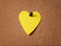 Heart shape sticky note on cork board Stock Images