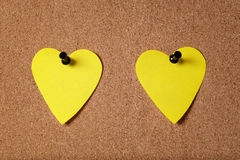 Heart shape sticky notes on cork board Stock Photos