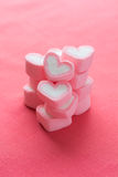 Heart shape strawberry marshmallows. On pink background stock photo