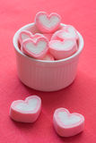 Heart shape strawberry marshmallows. On white cup stock photo