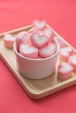 Heart shape strawberry marshmallows. On white cup royalty free stock photo