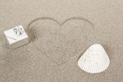 Heart shape symbol drawn in sand Royalty Free Stock Photography