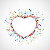 Heart shape symbol over colorful confetti or holi background. White frame with particle dust beneath. Anniversary festive greetings card template layout Stock Photography