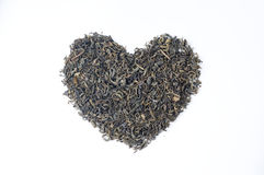 Heart shape tea leaves Royalty Free Stock Images