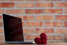 Heart shape toy and laptop Stock Image