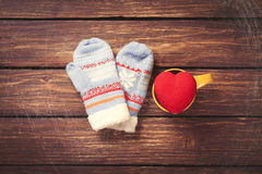 Heart shape toy and mittens Stock Photos