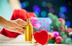 Heart shape toy and perfume Royalty Free Stock Photos
