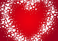 Heart shape Valentines Day card spray painted with random scatter hears. Heart shape Valentines Day card spray painted with random white scatter hears on red Stock Image
