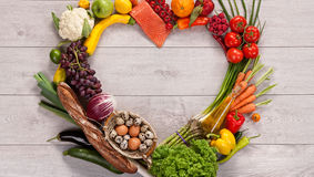 Heart shape by various vegetables and fruits royalty free stock images