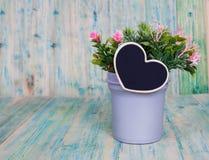 Heart shape in vase on wooden Stock Image