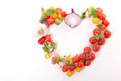 Heart shape with vegetables. Above royalty free stock photo