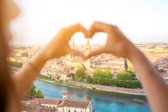 Heart shape on Verona cityscape background Stock Photos