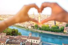 Heart shape on Verona cityscape background Stock Image