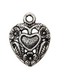 Heart shape vintage metal pendant Stock Photography