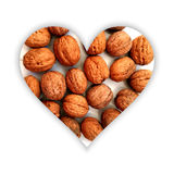 Heart shape with walnuts inside Royalty Free Stock Image