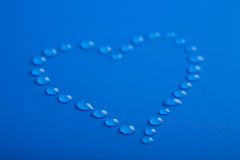 Heart shape of water droplets Royalty Free Stock Photos
