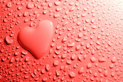 Heart shape with water drops Stock Photos