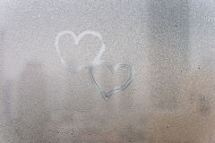 Heart shape on wet window surface Royalty Free Stock Photography
