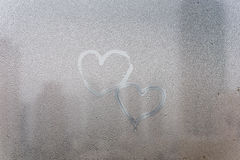 Heart shape on wet window surface Royalty Free Stock Image
