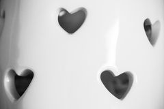 Heart shape on white ceramic. For valentine blackground stock photos