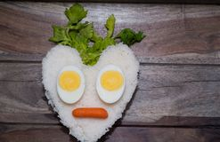 Heart shape of white rice and eggs. With carrots Royalty Free Stock Images