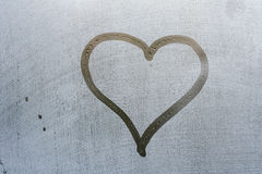 Heart shape on window. Heart shape drawn in condensation on glass window Royalty Free Stock Photography