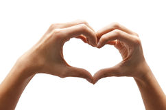 Heart shape woman hand making. On white background royalty free stock photos