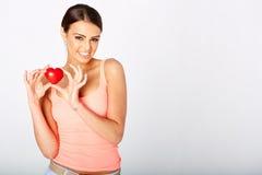 Heart shape in woman's hands Stock Photo
