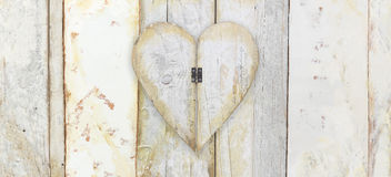 Heart shape on wood planks grunge texture background Stock Photos