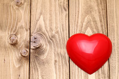 Heart shape on wooden background Stock Images