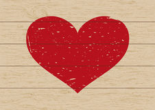 Heart shape on wooden background Stock Photography