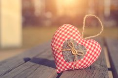 Heart shape on the wooden bench Stock Photos