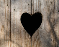 Heart shape wooden toilet outdoor bathroom door Stock Photography