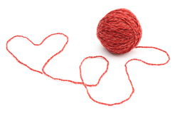 Heart shape and wool ball on white background Royalty Free Stock Photo