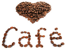 A heart shape with the word Cafe created with coffee beans Royalty Free Stock Photos