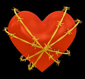 Heart shape wrapped with golden barbed wire Royalty Free Stock Photo