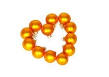 Heart shape of yellow Christmas balls Stock Images