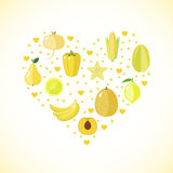 Heart shape with yellow fruits and vegetables Stock Photography