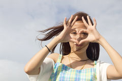 Heart shape. young woman making Royalty Free Stock Image
