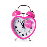 Heart shaped alarm clock Stock Image