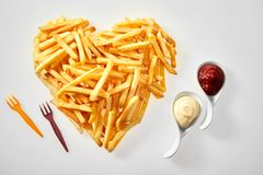 Heart shaped arrangement of French fries royalty free stock photography