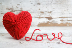 Heart-shaped ball of yarn, with words of love Stock Photos