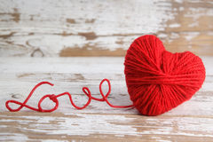 Heart-shaped ball of yarn, with words of love Stock Images