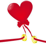 Heart-shaped balloon with golden rings Royalty Free Stock Photo