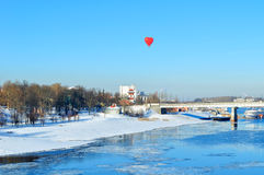 Heart-shaped balloon over the road bridge in Veliky Novgorod, Russia. Winter city view. Royalty Free Stock Photography
