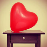 Heart-shaped balloon Stock Photos