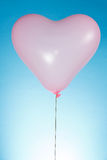 Heart shaped balloon Stock Images