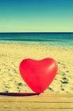 Heart-shaped balloon Stock Image