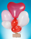 Heart shaped balloons and gift Royalty Free Stock Photos