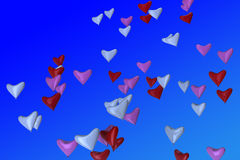 Heart-shaped balloons in sky Stock Photography
